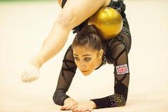 体操运动员执行在Irina Deleanu桔子战利品 免版税库存照片
