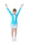 体操运动员行使的小女孩 免版税库存图片