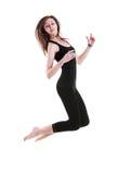 体操运动员跳 免版税图库摄影