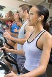 体操连续踏车妇女 免版税库存照片