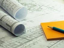体系结构计划,与橙色稠粘的技术项目图画 库存照片
