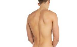 体育和健身题目:站立赤裸运动的人隔绝在白色背景在演播室,人的解剖学 免版税库存照片