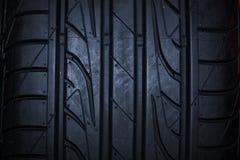 体育在黑背景的夏天轮胎 免版税图库摄影