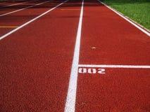 体育场的红色跑马场 免版税库存照片