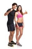 体育夫妇-男人和妇女在健身以后在白色行使 库存照片