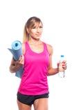 体育概念-美丽的亭亭玉立的运动的妇女与 免版税库存图片