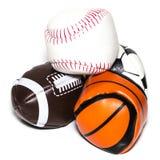 体育球的汇集与足球、橄榄球、棒球和篮子的 库存照片