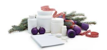 体育营养和圣诞装饰 免版税库存图片