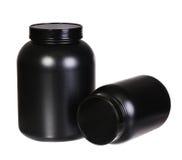 体育营养、乳清蛋白和获得者黑塑料瓶子的 图库摄影