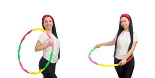体育衣服的一个女孩与在白色隔绝的hula箍 图库摄影