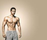 体育运动 年轻肌肉男性的图象 库存照片