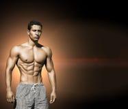 体育运动 年轻肌肉男性的图象 免版税库存图片