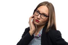 体贴的妇女照片用在嘴附近的手 库存照片