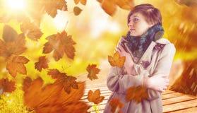 体贴的妇女的综合图象冬天外套的 免版税库存图片