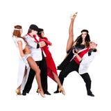 余兴节目在葡萄酒服装穿戴的舞蹈家队 图库摄影