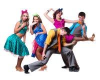余兴节目舞蹈演员小组跳舞 查出在全长的空白背景 库存图片