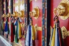 佛教寺庙墙壁的五颜六色的装饰在尼泊尔 免版税库存照片