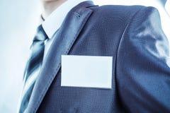 作为一位成功的经理的躯干有一枚空白的徽章的 免版税库存图片