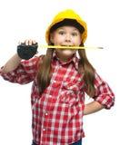 作为一名建筑工人的女孩有卷尺的 图库摄影