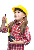 作为一名建筑工人的女孩有卷尺的 库存图片