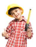 作为一名建筑工人的男孩有卷尺的 免版税库存照片