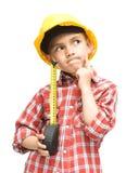 作为一名建筑工人的男孩有卷尺的 免版税图库摄影