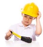作为一名建筑工人的男孩有卷尺的 库存照片