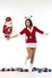 作为一白色backgrou的圣诞老人打扮的美丽的少妇 免版税库存照片