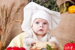 作为主厨逗人喜爱的孩子 免版税库存照片