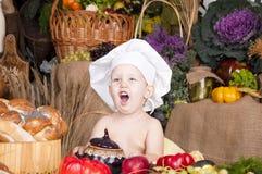 作为主厨逗人喜爱的孩子 免版税库存图片