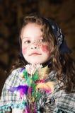 作为传统打扮的可爱的小女孩 库存照片
