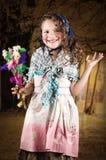 作为传统打扮的可爱的小女孩 库存图片