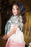 作为传统打扮的可爱的小女孩 免版税库存照片
