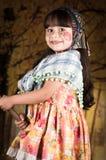 作为传统打扮的可爱的小女孩 免版税库存图片