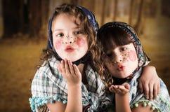 作为传统打扮的美丽的小女孩 库存图片
