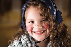 作为传统打扮的美丽的小女孩 免版税库存照片