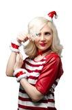 作为克劳斯加工好的女孩圣诞老人 免版税库存图片