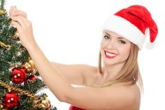 作为加工好的俏丽的圣诞老人妇女 库存图片