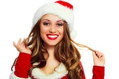 作为加工好的圣诞老人性感的妇女 库存照片