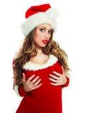 作为加工好的圣诞老人性感的妇女 免版税库存图片