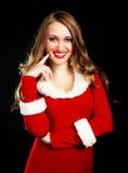 作为加工好的女孩圣诞老人 免版税库存照片
