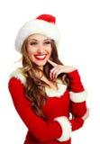 作为加工好的女孩性感的圣诞老人 免版税库存图片
