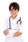 作为医生穿戴的孩子年轻人 库存图片