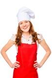 作为厨师打扮的愉快的主妇 库存照片