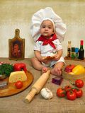作为厨师的男婴 免版税库存图片