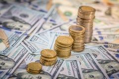 作为图的欧洲硬币在美元上 免版税库存照片
