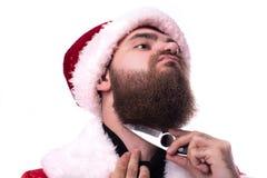 作为圣诞老人打扮的人 库存照片