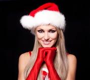 作为圣诞老人打扮的妇女 库存图片