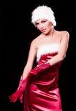 作为圣诞老人打扮的妇女 免版税库存图片