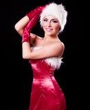 作为圣诞老人打扮的妇女 免版税图库摄影